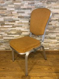 Burgess Stacking Chair with Aluminium Frame and Gold Upholstery.